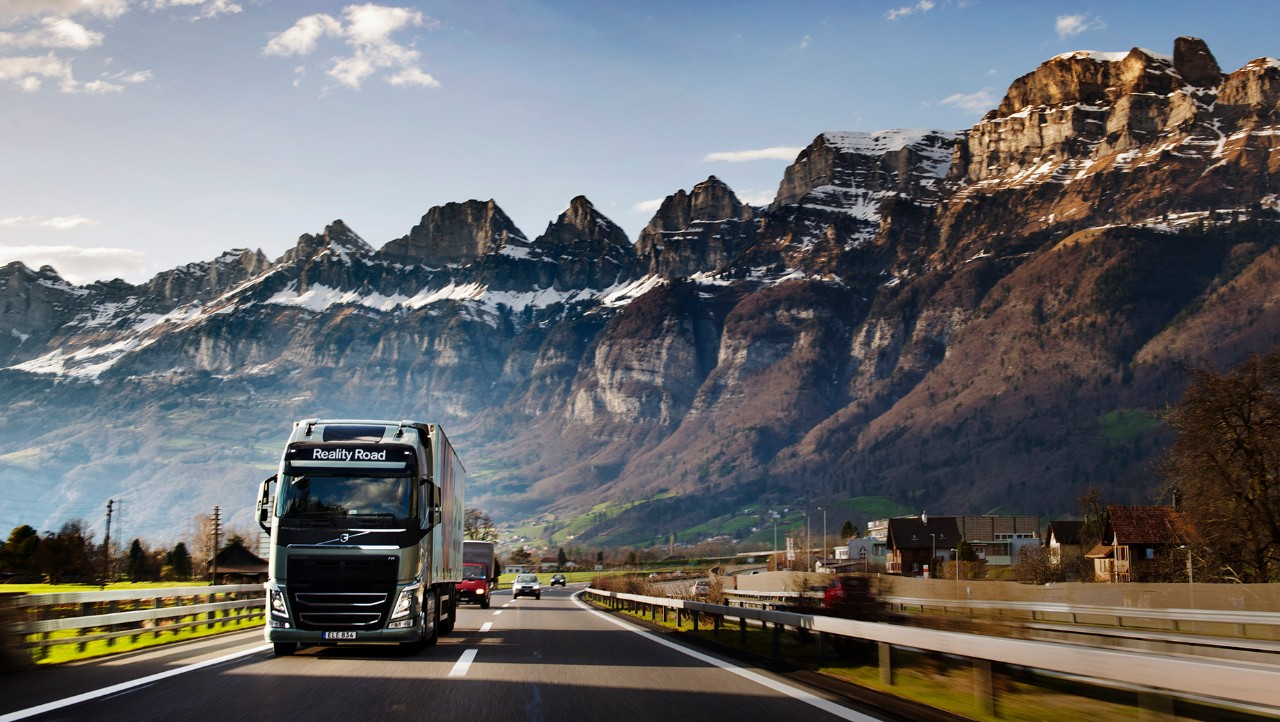 Volvo FH driving in front of mountain landscape